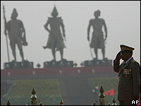 Burma junta leader Than Shwe salutes troops on Armed Forces Day, in the shadow of statues of Burma kings, in the new capital Naypyidaw on 27 March 2007