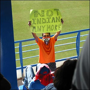 An India fan brandishing a banner