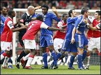 Players from Arsenal and Chelsea confront each other during the Carling Cup final
