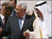 King Abdullah of Saudi Arabia (right) talks with Palestinian leader Mahmoud Abbas in Riyadh