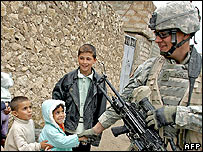 A US soldier shakes hands with Iraqi children in Talafar