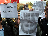 Iranian students protest against President Mahmoud Ahmadinejad by holding his portrait upside-down, Dec 2006