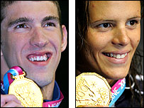 Michael Phelps (L) and Laure Manaudou