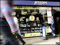 Shoppers walk past Jessops store
