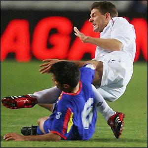 Steven Gerrard challenges Jordi Escura
