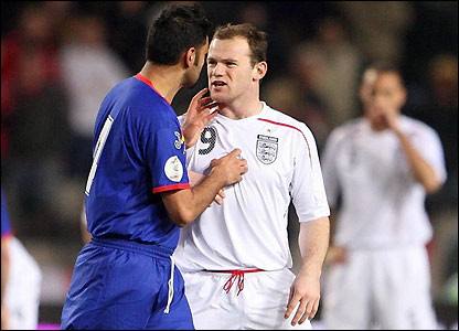 Wayne Rooney is confronted by Oscar Sonejee