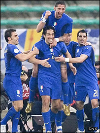 Italy celebrate the first of Luca Toni's goals in Bari