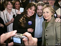 Hillary Clinton poses for a photo with supporters in New Hampshire
