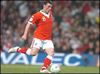 Jason Koumas takes a penalty for Wales against San Marino