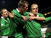David Healy is congratuled after scoring against Sweden