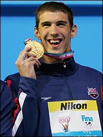 Michael Phelps celebrates winning the 200m individual medley