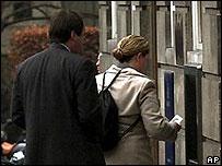 Bank customers at an ATM