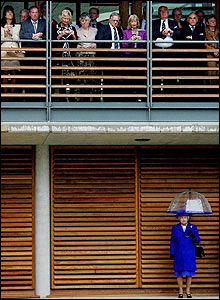 The miserable weather forces the Queen to take shelter