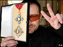 Bono receiving his honorary knighthood
