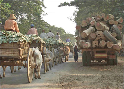 Carts and a teak truck on road to Naypyidaw