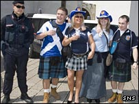 Scotland fans under the watchful eye of the Italian police