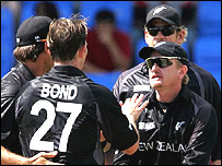 Bond celebrates the first of his three wickets in Antigua