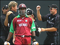 Samuels walks after being dismissed by Oram, background