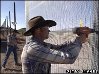 Minutemen building fence in Texas