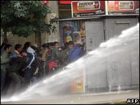Police fire water cannon at protesters in Santiago