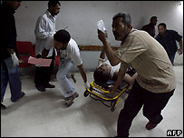 Wounded man rushed for treatment at Baghdad hospital