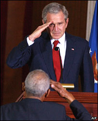 President George W Bush salutes the Tuskegee Airmen during the medal ceremony
