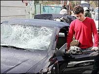 Car damaged during clash between rival Greek fans