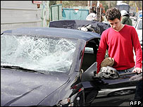 Car damaged during clash between rival Greek fans