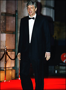 Arsenal boss Arsene Wenger walks up the red carpet
