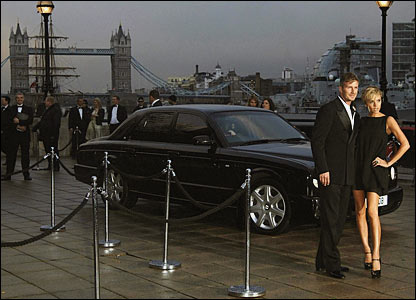 London Bridge provides a spectacular back-drop as David and Victoria Beckham arrive