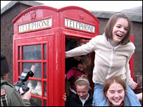 Sixteen young gymnasts crammed into the phone box