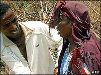 A wounded Somali woman is given assistance by a relative