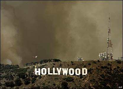 Smoke billows above the Hollywood hills