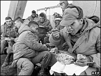Argentine soldiers take a lunch break during the invasion