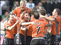 Dundee United celebrate their late goal