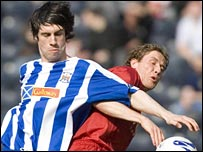 Rocco Quinn and Aberdeen's Chris Clark tussle at Rugby Park