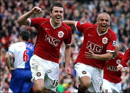 Michael Carrick and Wes Brown celebrate at Old Trafford