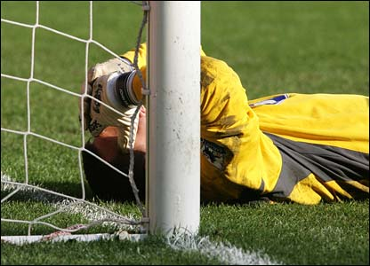 Wigan keeper John Filan holds his head in his hands after letting in a penalty