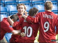 The Dons celebrate at Rugby Park