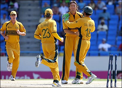 McGrath and team-mates celebrate the second wicket