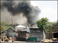 Smoke rises from burning buildings in Mogadishu