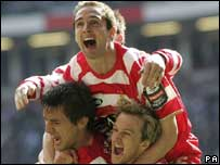 Doncaster celebrate the winning goal at the Millennium Stadium