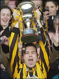 Skipper Oisin McConville holds the Andy Merrigan Cup aloft after Crossmaglen's win at Portlaoise