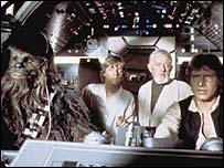 Peter Mayhew, Mark Hamill, Alec Guinness and Harrison Ford in Star Wars