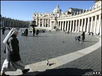 A nun walks towards the Vatican