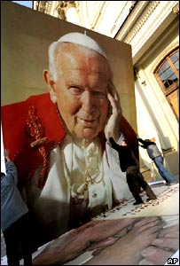 A large picture of Pope John Paul in the Vatican