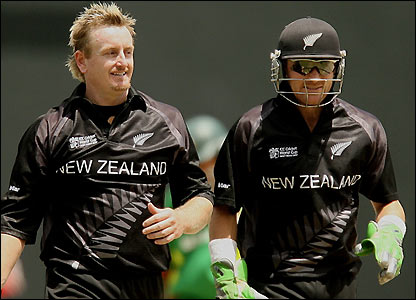 Scott Styris exchanges words with wicket-keeper McCullum after his wicket