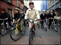 Mexico City's Mayor Marcelo Ebrad goes to work on a bike in Mexico City