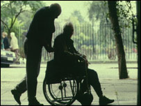 Carer with person in wheelchair