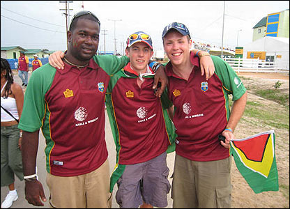"Ben Biggs: ""This is a photo of me and Hugh with our Guyanese friend, Terrances, showing support for the West Indies in their crunch game with Sri Lanka"""